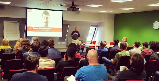 A photo of Paul Bailey introducing the Summer School at Conference Aston